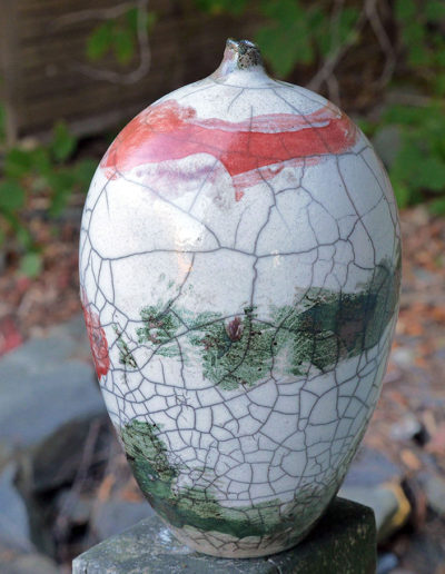 Oakley Way Potter raku vase in red and green